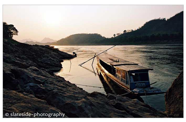 Laos Louangphabang river boat mekong