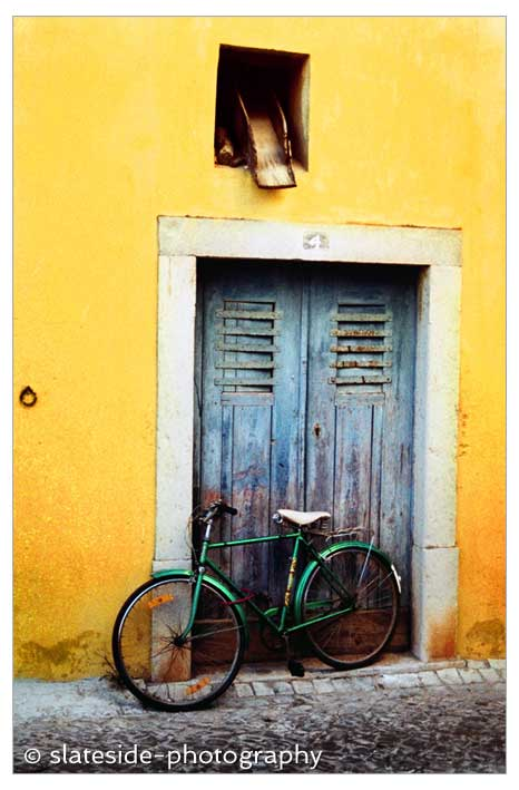 portugal street bike colourful door